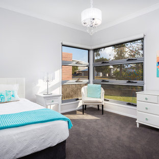 Inspiration for a transitional bedroom in Brisbane with grey walls, carpet and black floor.