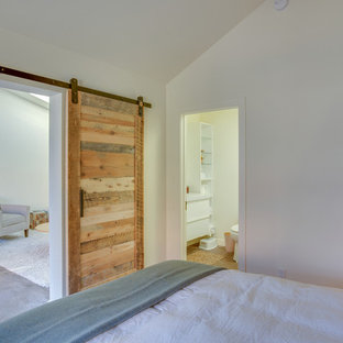 Design ideas for a small traditional master bedroom in San Francisco with white walls, concrete flooring and no fireplace.