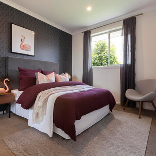 This is an example of a contemporary guest bedroom in Melbourne with beige walls, carpet, no fireplace, brown floor and wallpaper.