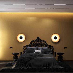 Immagine di una camera matrimoniale minimalista con pareti gialle, parquet scuro, nessun camino e pavimento nero