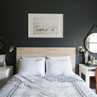 Inspiration for a mid-sized eclectic master carpeted and beige floor bedroom remodel in Atlanta with black walls and no fireplace