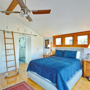 Bedroom - craftsman medium tone wood floor and brown floor bedroom idea in Los Angeles with gray walls