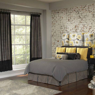 Example of a mid-sized transitional guest dark wood floor and brown floor bedroom design in Nashville with gray walls