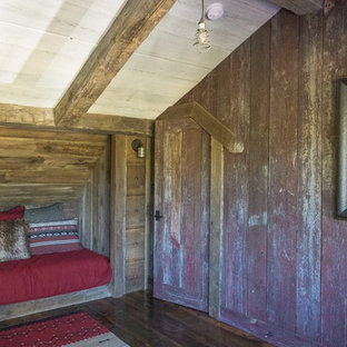 Inspiration for a rustic guest medium tone wood floor bedroom remodel in Denver with no fireplace
