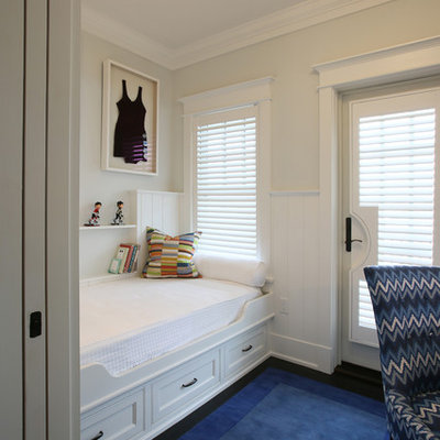 Example of a small beach style guest dark wood floor bedroom design in Philadelphia with white walls