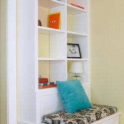 Built -in Seat with Drawers - A little bit different and a lot more functional than the standard 'shelves above base cabinet' format that is so ...everywhere. With this setup you get large capacity drawers and a place to sit and read your books.
