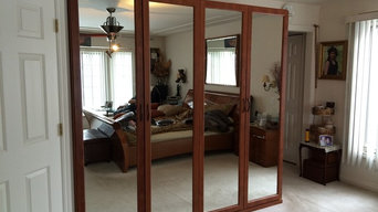 Built-out Wardrobe Closet with Mirrored Doors