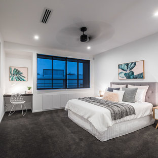 Photo of a contemporary master bedroom in Brisbane with white walls, carpet and grey floor.
