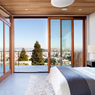 Exemple d'une chambre parentale moderne avec un mur blanc, un sol en ardoise et aucune cheminée.