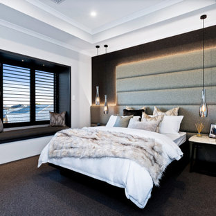This is an example of a mid-sized contemporary master bedroom in Perth with white walls, carpet and black floor.