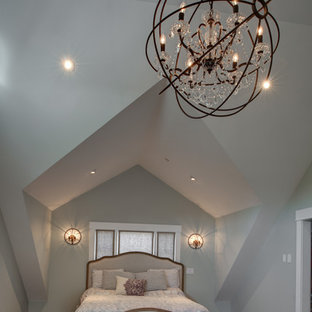 Mid-sized arts and crafts master medium tone wood floor bedroom photo in San Francisco with blue walls