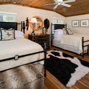 Inspiration for a cottage guest dark wood floor and brown floor bedroom remodel in Other with beige walls