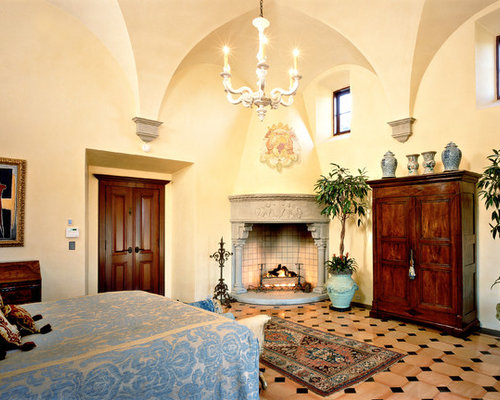Mediterranean bedroom idea in DC Metro with a corner fireplace and a stone  fireplace surround - Corner Entertainment Armoire Houzz