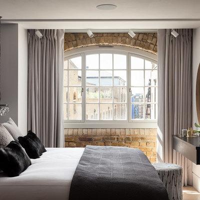 Trendy master beige floor bedroom photo in London with white walls