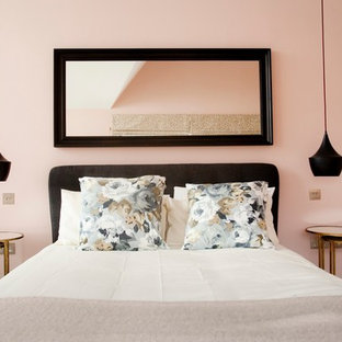 Transitional master bedroom photo in Surrey with pink walls