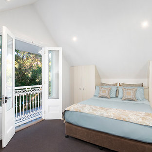 Inspiration for a mid-sized transitional guest bedroom in Sydney with white walls, carpet, no fireplace and brown floor.
