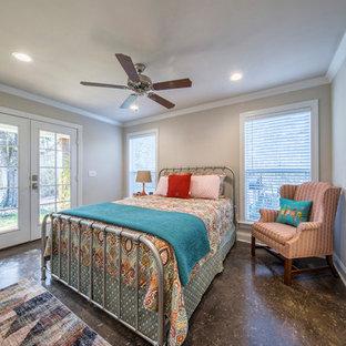 Bedroom - small rustic master concrete floor and black floor bedroom idea in Other with beige walls