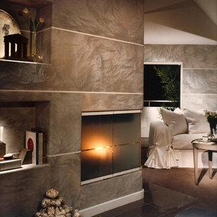 Imagen de dormitorio principal, minimalista, grande, con paredes grises, suelo de linóleo, chimenea de esquina y marco de chimenea de baldosas y/o azulejos
