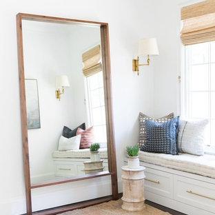 Foto de dormitorio principal, tradicional renovado, grande, con paredes blancas, suelo de madera oscura y suelo marrón