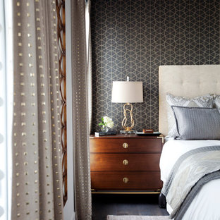 Mid-sized trendy master dark wood floor and black floor bedroom photo in Calgary with white walls and no fireplace