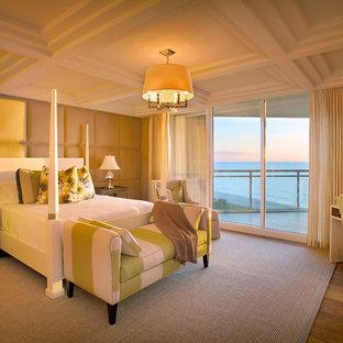 Trendy medium tone wood floor bedroom photo in Other with beige walls