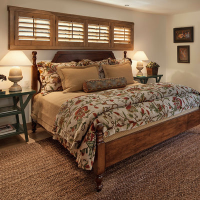 Inspiration for a rustic bedroom remodel in Santa Barbara with white walls