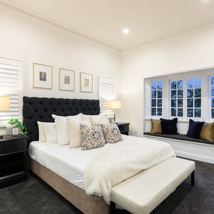 Inspiration for a transitional bedroom in Brisbane with white walls, carpet and black floor.
