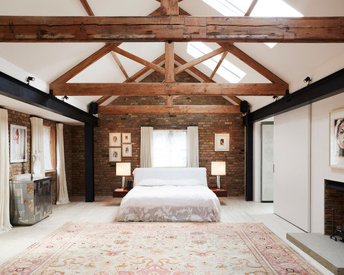 Large Industrial Master Bedroom In London With Red Walls, Light Hardwood  Flooring, A Standard