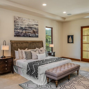 Design ideas for a large transitional guest bedroom in Other with beige walls, carpet, no fireplace, beige floor and recessed.
