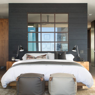 Design ideas for a large modern master bedroom in San Diego with grey walls, dark hardwood floors and brown floor.