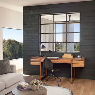 Example of a large minimalist master dark wood floor and brown floor bedroom design in San Diego with gray walls