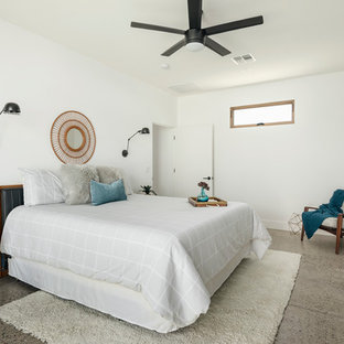 Inspiration for a small contemporary master bedroom in Phoenix with white walls, concrete floors and grey floor.