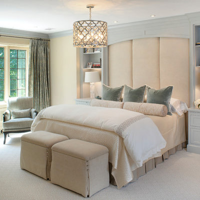 Example of a transitional carpeted bedroom design in Columbus with beige walls