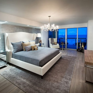 Inspiration for a contemporary master bedroom remodel in Miami with gray walls