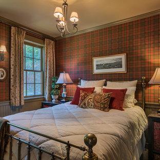 Imagen de dormitorio rústico con paredes rojas
