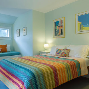 Example of a coastal bedroom design in Boston with blue walls