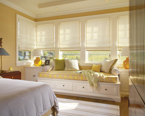 Inspiration for a timeless medium tone wood floor bedroom remodel in Orange  County with beige walls
