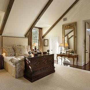Bedroom - traditional dark wood floor bedroom idea in Los Angeles with beige walls