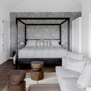 Design ideas for a contemporary master bedroom in Other with grey walls, dark hardwood floors, brown floor, vaulted and wallpaper.