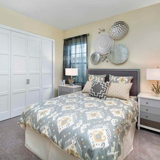 Bedroom - large coastal carpeted and beige floor bedroom idea in Miami with yellow walls