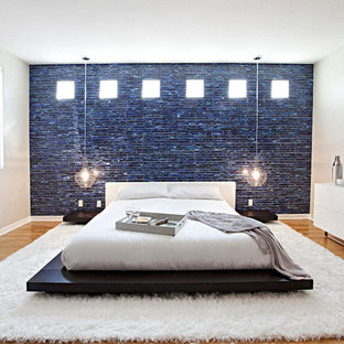 Inspiration for a large contemporary master medium tone wood floor bedroom remodel in Orange County with beige walls