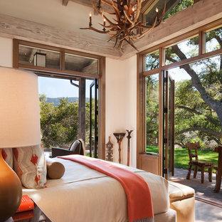 Bedroom - rustic master medium tone wood floor bedroom idea in San Francisco with beige walls and no fireplace