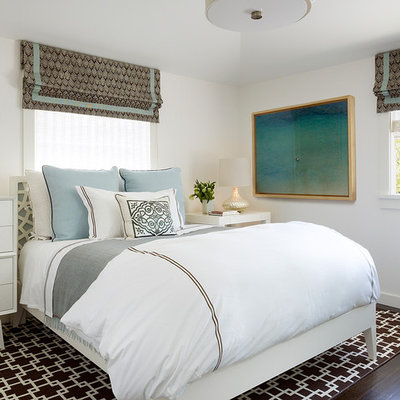 Inspiration for a contemporary dark wood floor bedroom remodel in San Francisco with white walls