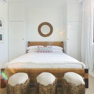 На фото: гостевая спальня среднего размера в морском стиле с белыми стенами, бетонным полом и белым полом без камина с