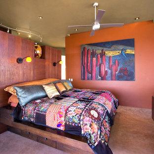 Ejemplo de dormitorio exótico con suelo de cemento y suelo rosa