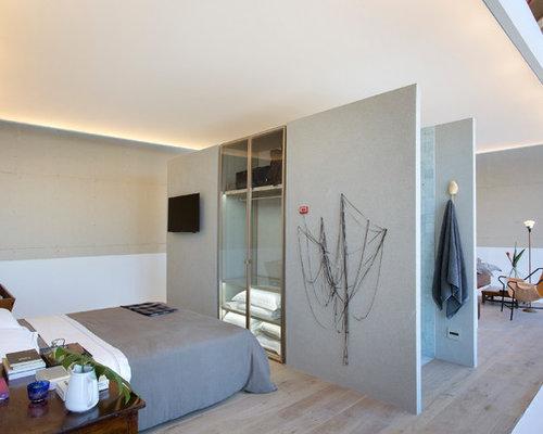 Example Of A Minimalist Light Wood Floor And Beige Floor Bedroom Design In  New York With