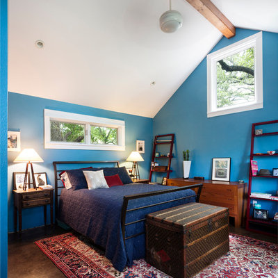 Example of a mid-sized trendy master concrete floor bedroom design in Austin with blue walls