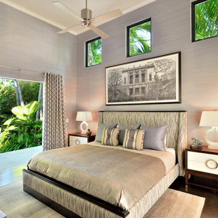Large trendy master dark wood floor and brown floor bedroom photo in Miami with gray walls and no fireplace