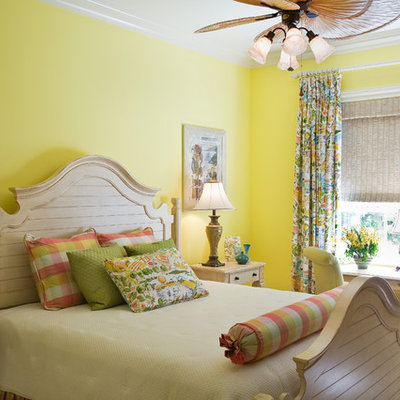 Example of an island style bedroom design in Miami with yellow walls