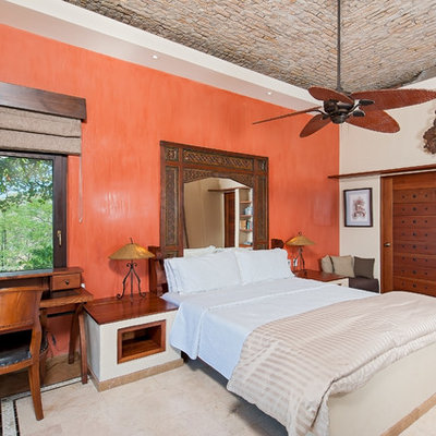 Inspiration for a mediterranean bedroom remodel in Other with orange walls